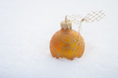 Golden ball on snow christmas Stock Photo