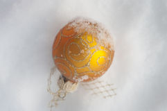 Golden ball on snow christmas Stock Photography