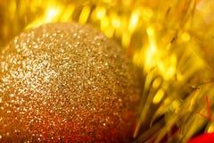 Golden ball and tinsel. macro Royalty Free Stock Photos