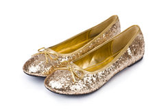 Golden ballet shoes. Isolated on white stock photos