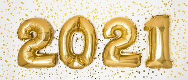 Golden 2021 balloons. Gold metallic foil numbers for Happy New Year celebration on white background with confetti stars