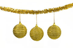 Golden balls - christmas decoration. On a white background Stock Photography