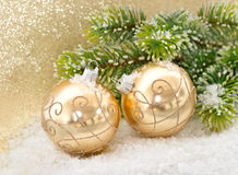 Golden balls with christmas tree branch Royalty Free Stock Photos