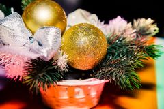Golden balls on the fir bough Christmas decoration. Two golden balls on the fir bough a  Christmas decoration royalty free stock image