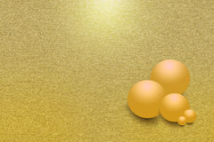 Golden balls on the golden metal background. Pattern of black metal background with black balls. Golden bigger balls are  in the foreground them Stock Photography