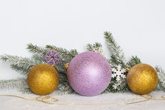 Golden balls, a golden thread, branches of a Christmas tree and Stock Image