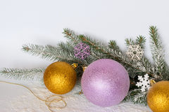 Golden balls, a golden thread, branches of a Christmas tree and Stock Photography