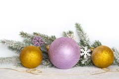 New Year card. Golden balls and new garland with Christmas tree branches. Golden balls, a golden thread, branches of a Christmas tree and snow. Christmas royalty free stock photo