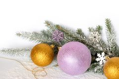 Golden balls, a golden thread, branches of a Christmas tree and snow. Christmas composition stock photography