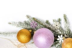 Golden balls, a golden thread, branches of a Christmas tree and snow. Christmas composition stock images