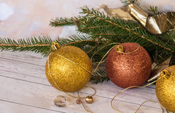Golden balls, a golden thread and a new garland with branches of Stock Photo