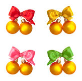 Golden balls with multicolored  satin bows Royalty Free Stock Image
