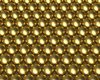 Golden ball pattern reflective balls. Gold metallic ball bearing tightly packed with reflective textures. Golden beads array Royalty Free Stock Images