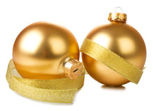 Golden balls with ribbon Stock Photography