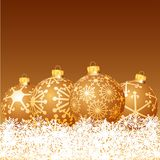 Golden balls in snow Royalty Free Stock Photos