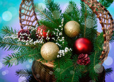 Golden balls are in a wicker basket. Red and golden balls are in a wicker basket Royalty Free Stock Photography