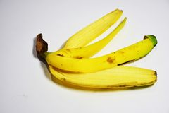 Golden banana peel, eaten whole But the shell. Golden banana, eat all the meat. But the shell, garbage from the banana peel, eaten. Give energy to the body Stock Photos