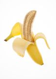 Golden Banana. Banana Skin Peeled Back to Show Golden Fruit Royalty Free Stock Images