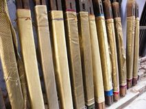 Golden Banarasi Silk Sarees on wooden stands. Many hand made golden Banarasi Silk Saree on the wooden stand stock image