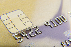 Golden bank card close-up Stock Image