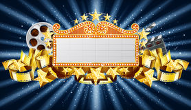 Golden banner. With stars, and film reel, with movie clapper Stock Photography