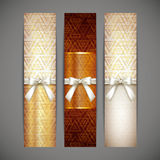 Golden banners with white bows and ribbons Stock Image