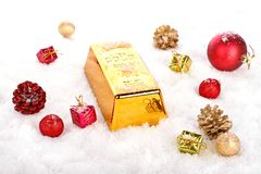 Golden bar and ornaments in the snow Stock Images