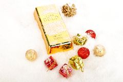 Golden bar and ornaments in the snow Royalty Free Stock Photo