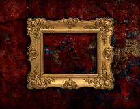 Golden baroque frame on a red grunge texture Stock Photo