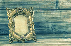 Golden baroque picture fram. Retro style toned picture Royalty Free Stock Photography