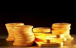 Golden bars and coins Royalty Free Stock Photos