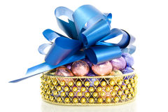 Golden basket with easter eggs Royalty Free Stock Photography