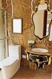 Golden Bathroom. Bathroom with mirror,white porcelain toilet,Golden wall stock photo