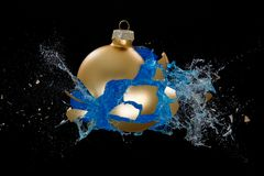 A golden bauble breaking Royalty Free Stock Photos