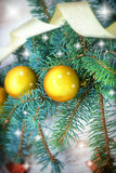 Golden bauble on Christmas tree Stock Images