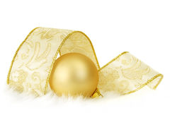 Golden Bauble and Ribbon Royalty Free Stock Photography