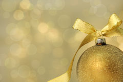 Golden bauble Stock Images