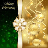 Golden baubles and bow Stock Images