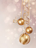 Golden  baubles hanging Stock Images