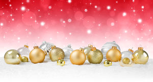 Golden Baubles on snow Stock Photography