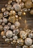Golden baubles threaded to make a wreath Stock Photography