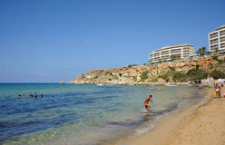 Golden Bay beach, Malta. Golden sand, azure water few people royalty free stock photos