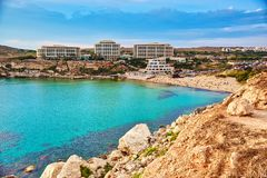 Golden Bay beach, Malta. The Golden Bay of Malta with sandy beach and clear blue water. Surrounded with luxury hotels stock photography