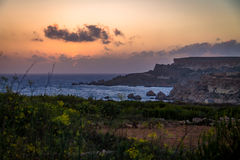 Golden Bay in Ghajn Tuffieha Tower sunset - Malta Royalty Free Stock Image
