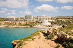Golden Bay, Malta. April 10, 2012: The Golden Bay of Malta with its sandy beach and the Radisson hotel royalty free stock image