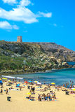 Malta, Sandy beach. View over the Golden Bay, sandy beach and a watchtower in the background, the north-western part of Malta Stock Photo