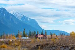 Golden, BC, CANADA - OCT 23, 2017: Train passing by the town of. Golden, with the Canadian Rockies in the background, taken from the town of Golden, British stock image