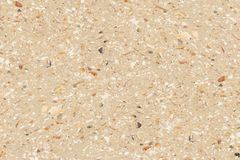 Beach sand with shell fragments. Golden beach sand with small broken and weathered shell fragments background Royalty Free Stock Photos