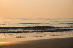 Golden beach sunrise morning Stock Images