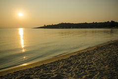Golden beach in the sunset Royalty Free Stock Photo